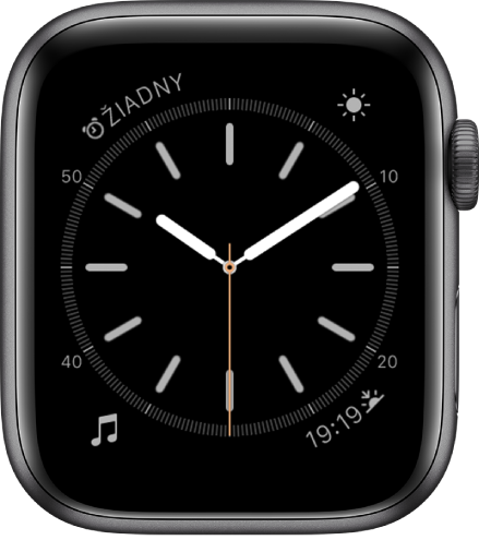 Ciferník Jednoduchý, na ktorom môžete upraviť farbu sekundovej ručičky, číslovanie adetaily číselníka. Zobrazujú sa štyri komplikácie: Budíky vľavo hore, Počasie vpravo hore, Hudba vľavo dole aVýchod/západ slnka vpravo dole.