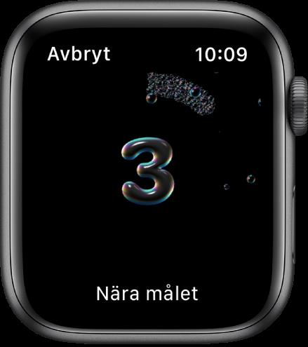 """Handtvättsräknaren som räknar ned från 3. Orden """"Nästan klar"""" visas längst ned på skärmen."""