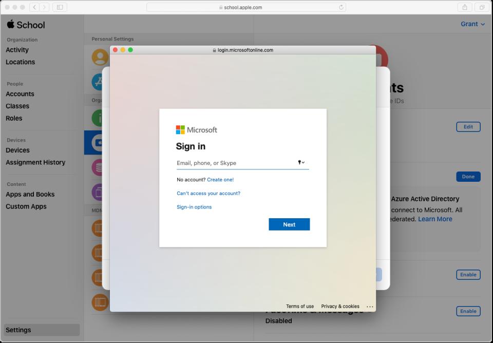 La ventana de inicio de sesión de AzureAD sobre la ventana de AppleSchoolManager.