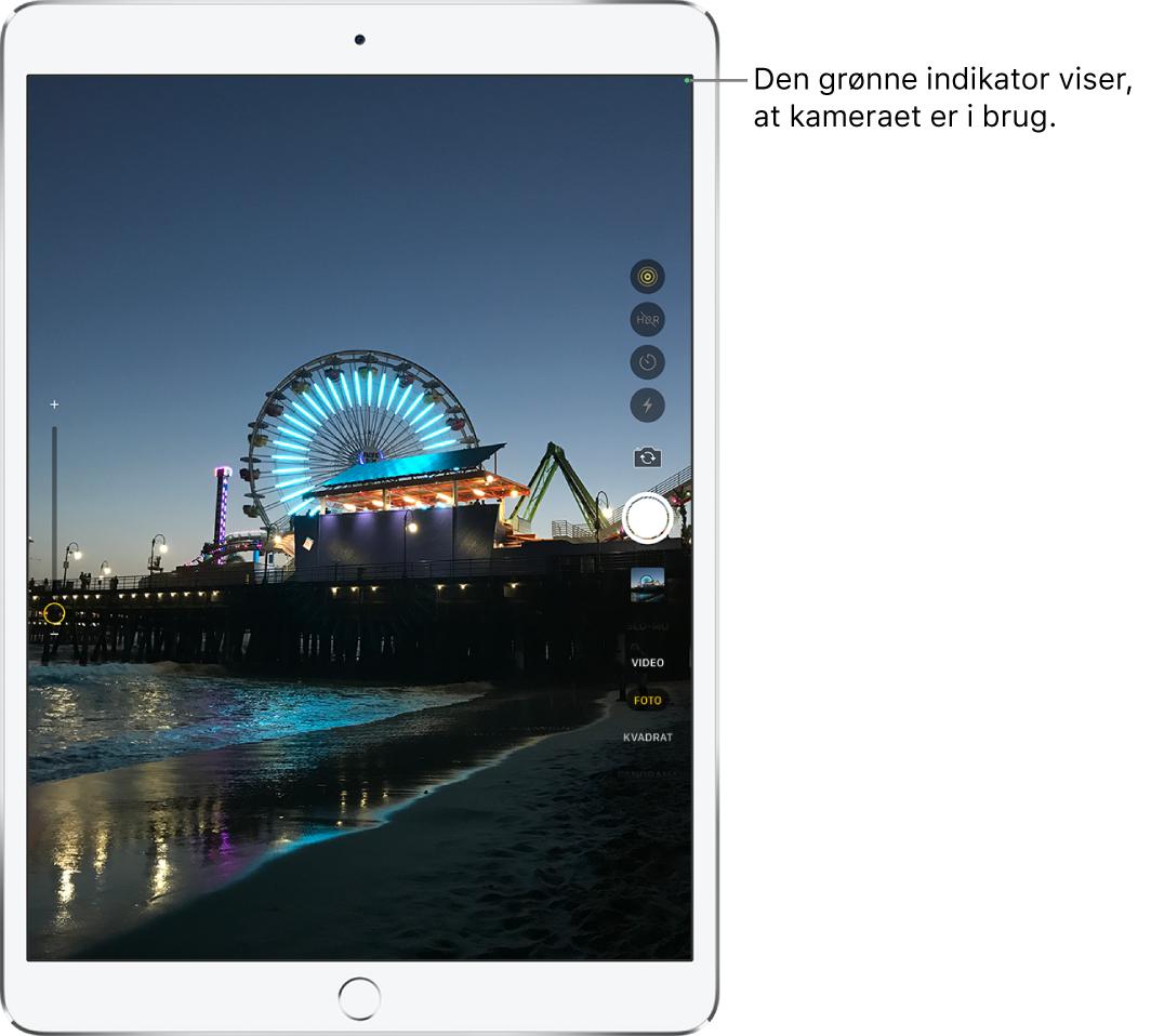 Skærmen Kamera. En grøn indikator øverst til højre viser, at kameraet er i brug.
