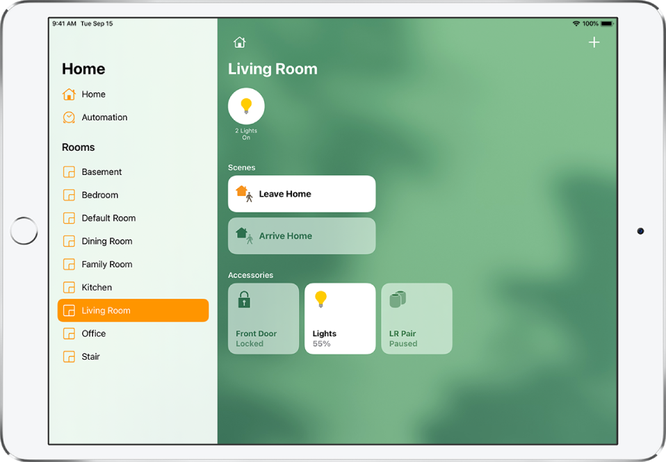The Home app with the sidebar on the left. Living Room is highlighted in the sidebar. To the right is a status button for two lights near the top, two scenes below, and three accessory buttons near the bottom.