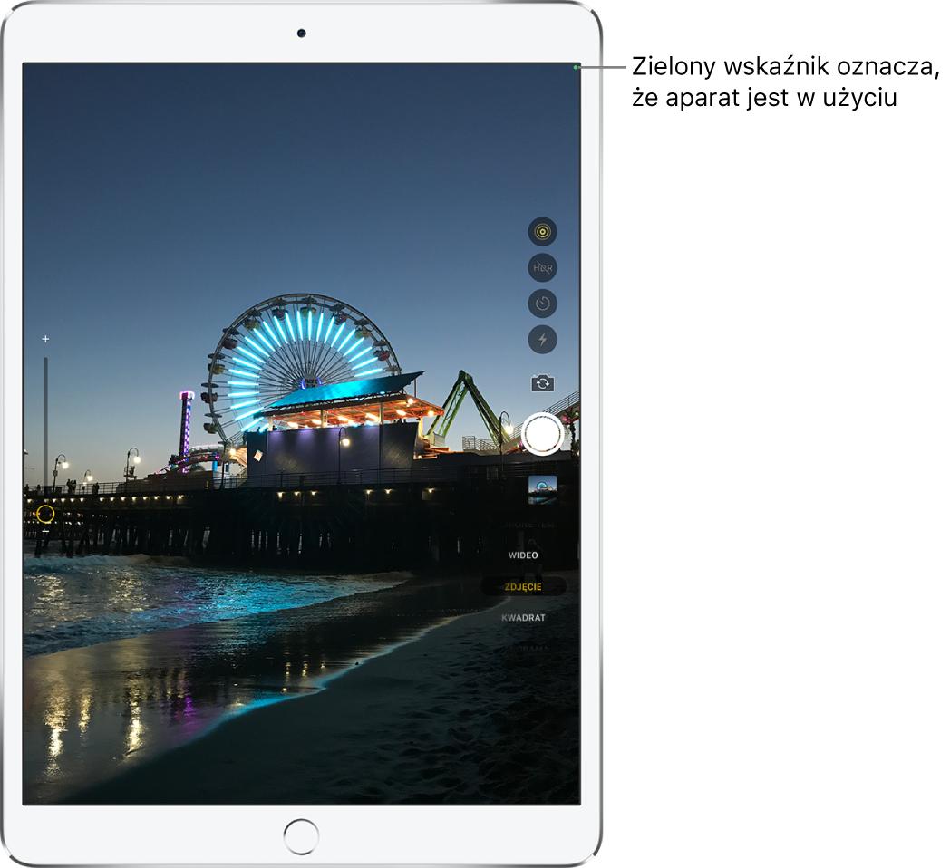 Ekran aplikacji Aparat. Zielony wskaźnik wprawym górnym rogu oznacza, że aparat jest wużyciu.