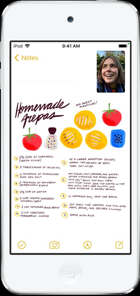 Pantalla con una conversación de FaceTime mientras se ve una receta en la app Notas, que ocupa el resto de la pantalla.