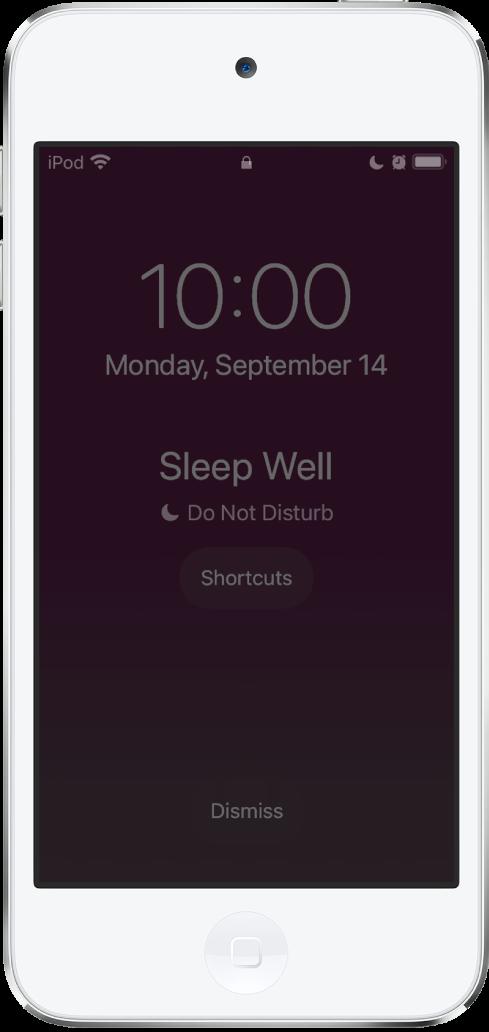 """หน้าจอ iPod touch ที่แสดง """"นอนหลับฝันดี"""" และ """"ห้ามรบกวนเปิดอยู่"""" ตรงกลาง ด้านล่างคือปุ่มคำสั่งลัด ที่ด้านล่างสุดของหน้าจอคือปุ่มปิดทิ้ง"""