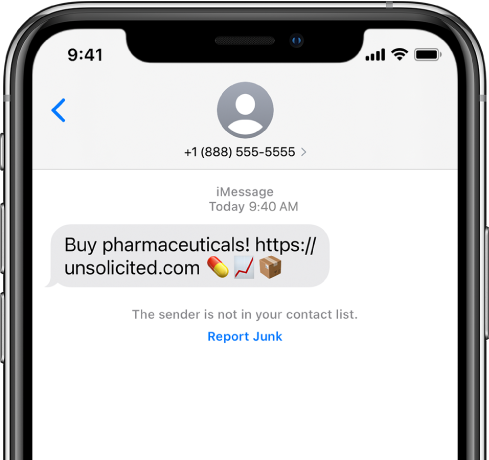 Percakapan iMessage dengan pesan spam dan tautan Laporkan Junk di bawahnya.