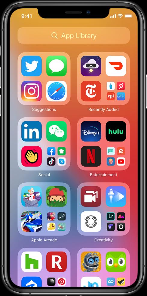 Biblioteca de Apps do iPhone mostrando os apps organizados por categoria (Sugestões, Adições Recentes, Utilitários, Social, Entretenimento, etc.).