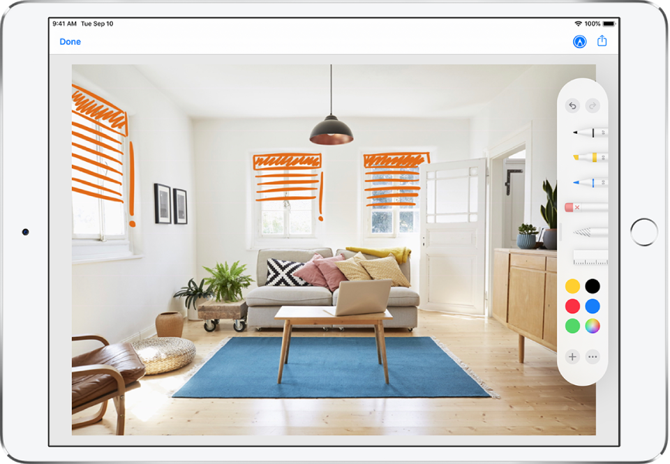 A photo fills the iPad screen. At the right side of the screen is the Markup Tool Palette, which includes the following markup tools from left to right: pen, marker, pencil, eraser, lasso, ruler, color picker, and the Add and More Options button. The Done button is in the top-left corner. The Mark Up button and the Share button are in the top-right corner.