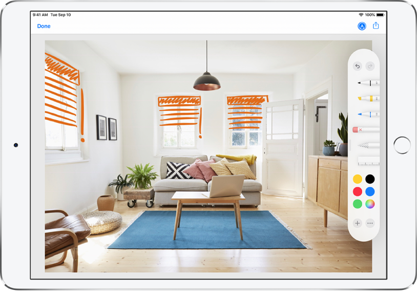 A photo is marked up with orange lines to indicate window blinds over windows. Drawing tools and color selections appear on the right of the screen.