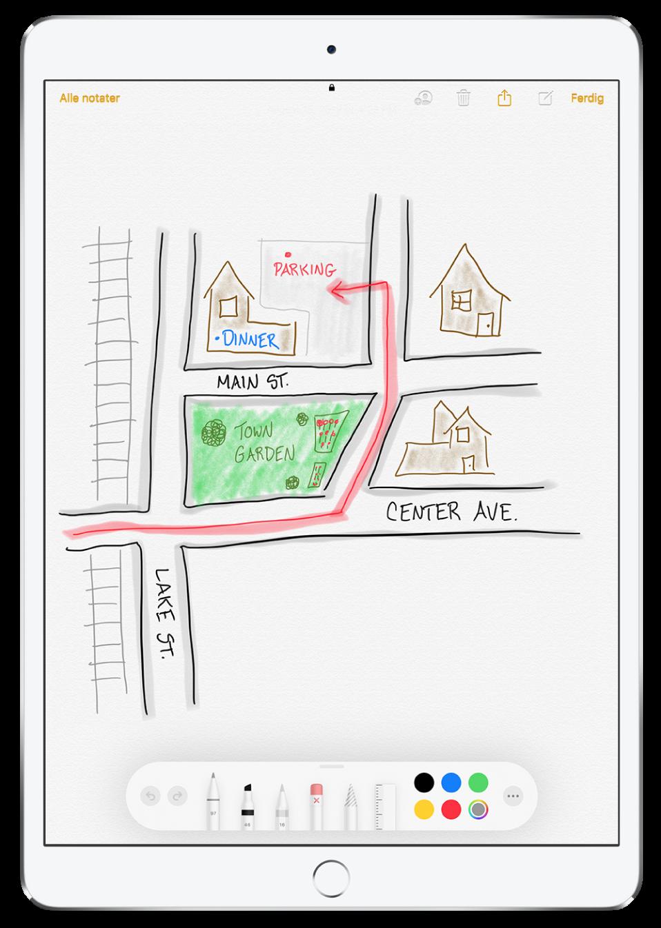 En tegning av et nabolag i et notat i Notater-appen. Tegningen har også merkede gater og en rød pil som viser tilgjengelig parkering. Nederst på skjermen vises Merking-verktøylinjen med skriveredskap og tilpasset farge markert.