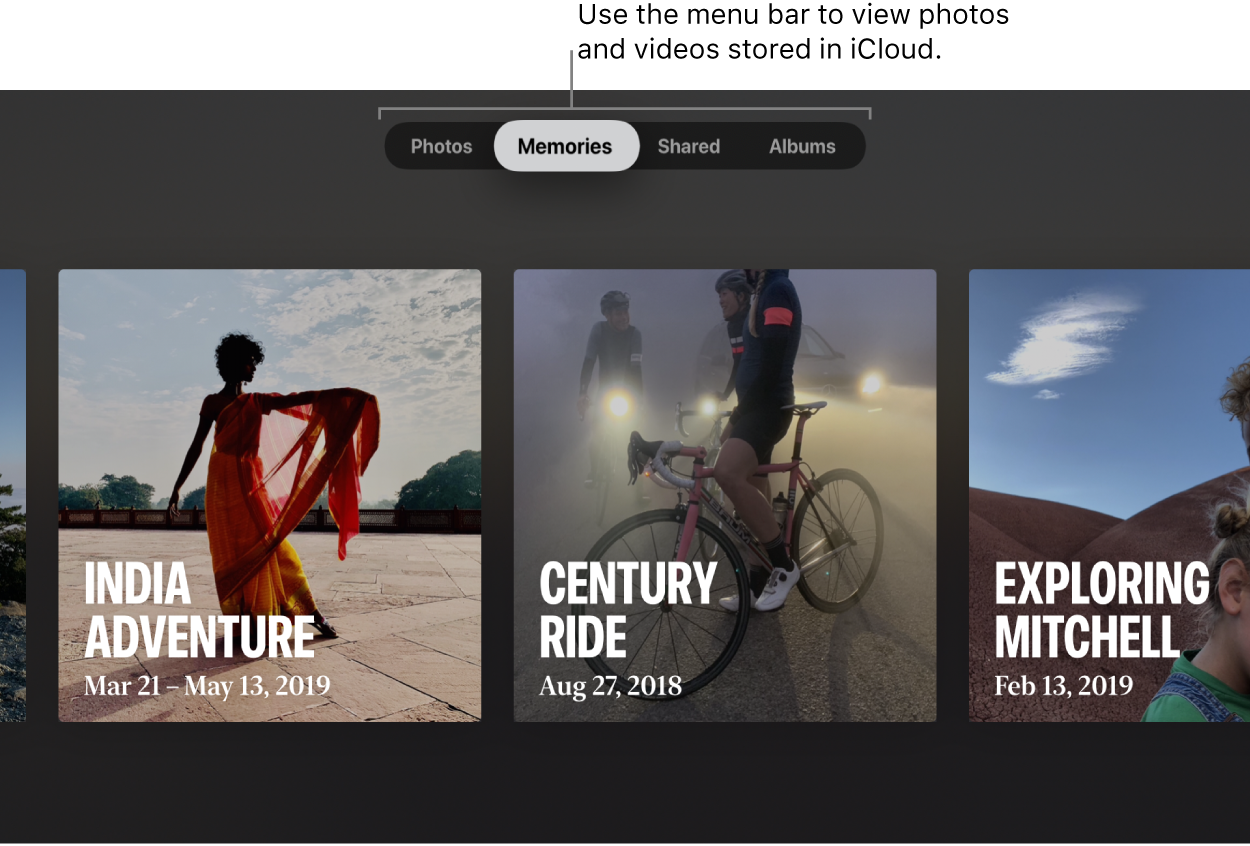 "The Photos app on an Apple TV. A line points to the menu bar, showing four options: Photos, Memories (selected), Shared, and Albums. The callout says: ""Use the menu bar to view photos and videos stored in iCloud."" Three Memories are visible: India Adventure, Century Ride, and Exploring Mitchell."