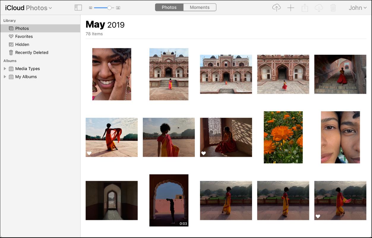 App Foto di iCloud.com. Foto yang dipilih dalam bar sisi dan foto dari Mei 2019 boleh dilihat.