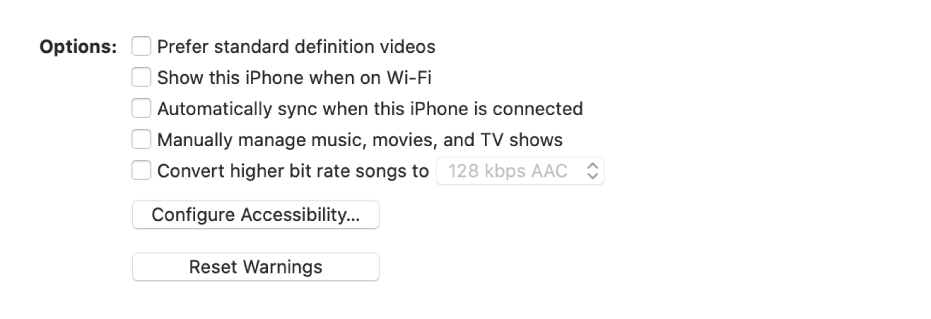 """The sync options showing checkboxes to manually manage content items, automatically sync, and display the device when connected over Wi-Fi. The """"Prefer standard definition videos"""" and """"Convert high bit rate songs to"""" options also appear. A Configure Accessibility button and a Reset Warning button also appear."""