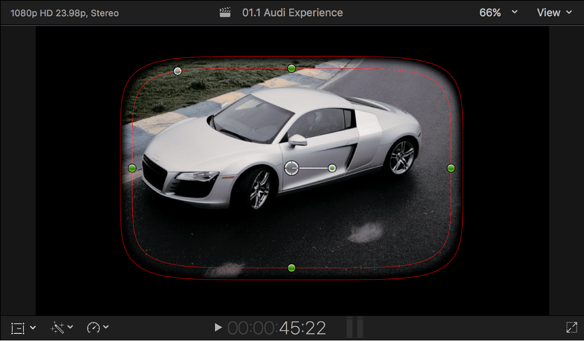 The viewer showing the default onscreen controls for the Shape Mask: a partially feathered rounded rectangle shape in the center of the frame