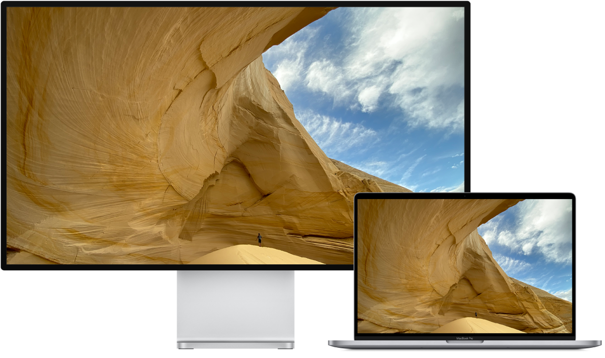 A MacBook Pro next to an HDTV used as an external display.