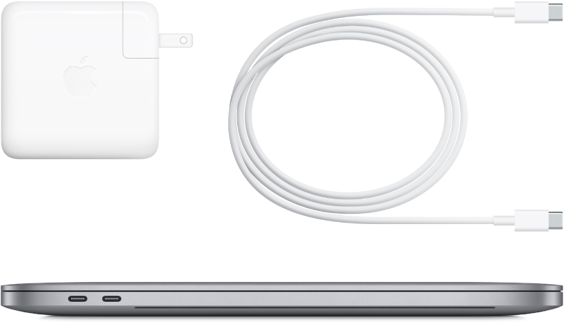 Side view of 16-inch MacBook Pro with accompanying accessories.