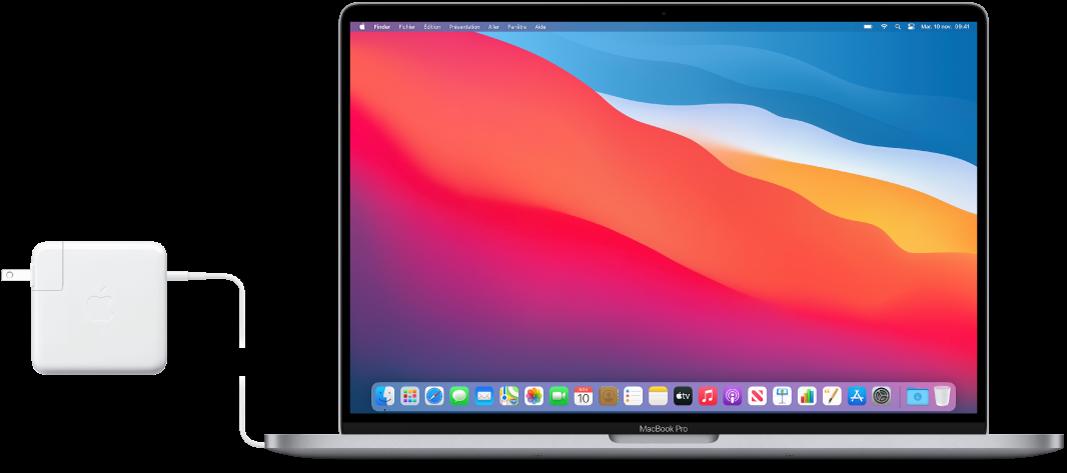Un MacBookPro avec l'adaptateur secteur branché.