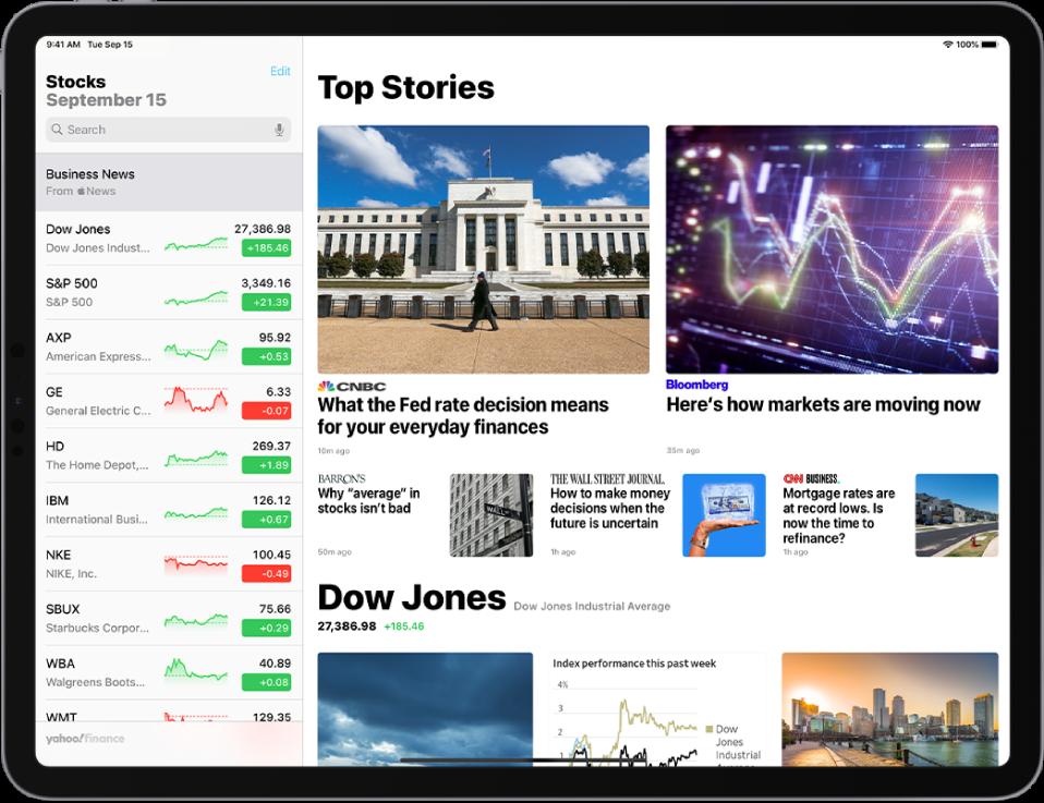 """""""Stocks"""" ekranas horizontalioje padėtyje. Paieškos laukas yra viršutiniame kairiajame kampe. Po paieškos lauku yra stebėjimo sąrašas. """"Top Stories"""", susijusios su akcijomis iš stebėjimo sąrašo, užpildo likusią ekrano dalį."""