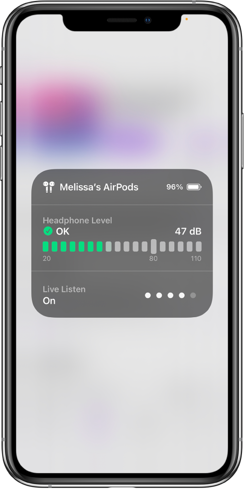 A card overlaying the screen. The card shows a graph of the headphone level for a pair of AirPods. The graph shows 47 decibels and is labeled OK. Below the graph, Live Listen is shown as On. The sound level of Live Listen is shown by four dots illuminated out of five.