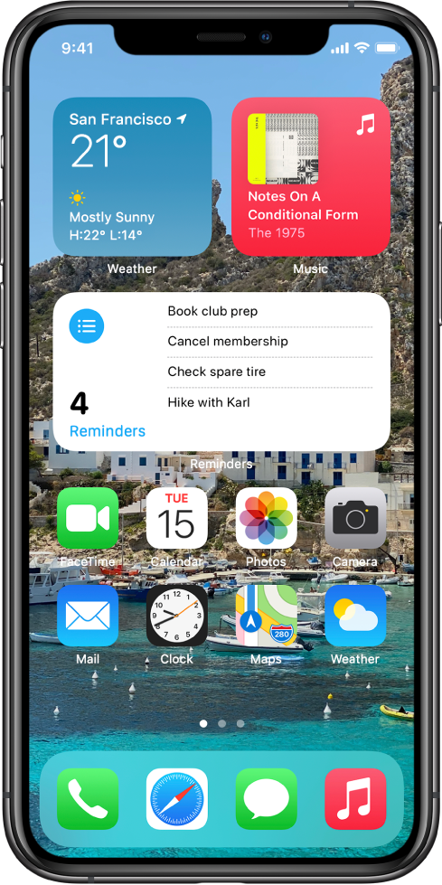 Layar Utama, menampilkan widget Peta dan Kalender serta ikon app lainnya.