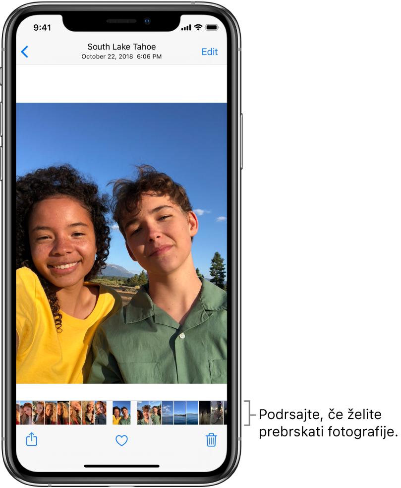 Fotografija s sličicami drugih fotografij na dnu zaslona. Zgoraj levo je gumb za vrnitev, ki vas vrne na pogled, po katerem ste brskali. Na dnu so prikazani gumbi »Share«, »Like« in »Delete«. Zgoraj desno je gumb »Edit«.