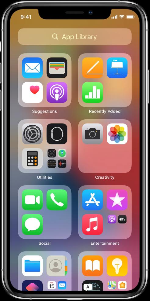 App Library v iPhonu, ki prikazuje aplikacije, urejene po kategorijah (Pripomočki, Ustvarjalnost, Družba, Razvedrilo itd.).