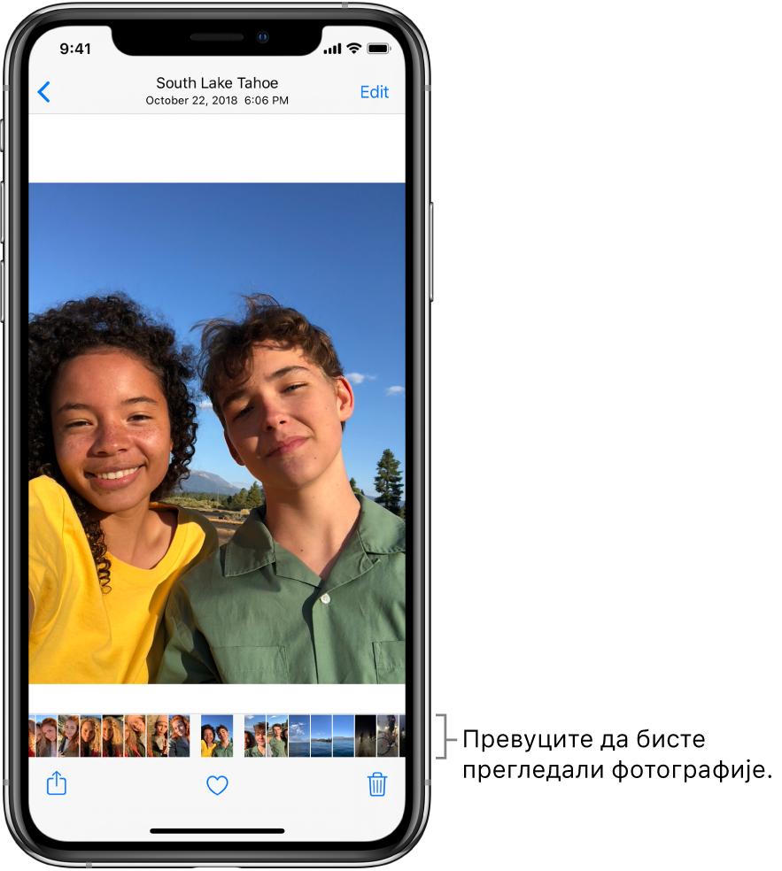 Фотографија са сличицама других фотографија дуж доњег дела екрана. У горњем левом углу се налази дугме за повратак, које вас враћа на приказ у ком сте прегледали. Дуж доње ивице се налазе дугмад Share, Like и Delete. У горњем десном углу се налази дугме Edit.