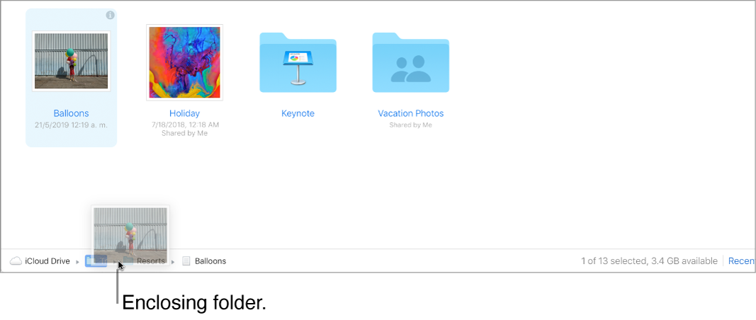A file being dragged to an enclosing folder at the bottom of the iCloudDrive window on iCloud.com.