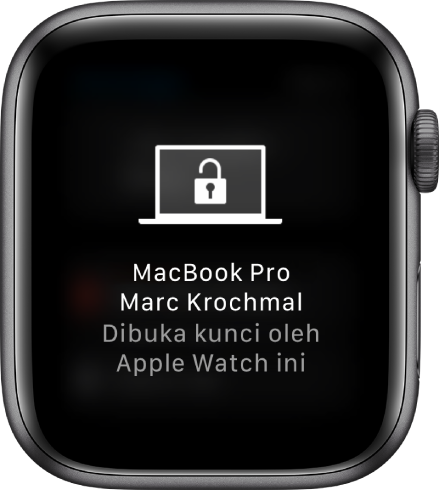 "Skrin Apple Watch menunjukkan mesej, ""MacBook Pro Marc Krochmal Dibuka Kunci oleh Apple Watch ini""."