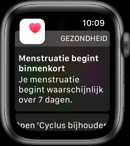 """AppleWatch met een scherm met informatie over een menstruatievoorspelling en de tekst """"Menstruatie begint binnenkort. Je menstruatie begint waarschijnlijk over 7dagen."""" Onderin staat de knop 'Open 'Cyclus bijhouden''."""