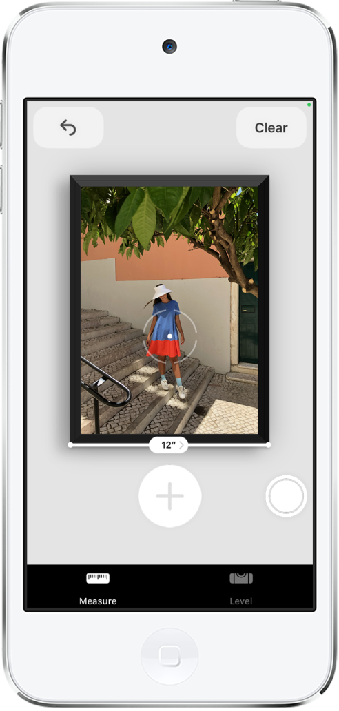 A framed photograph is measured, with its width showing at the bottom edge. The Take Picture button is in the lower-right corner. The green Camera In Use indicator appears at the top right.