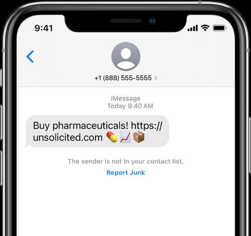 Бесіда iMessage із повідомленням-спамом і розташованим під ним посиланням «Заявити про спам».