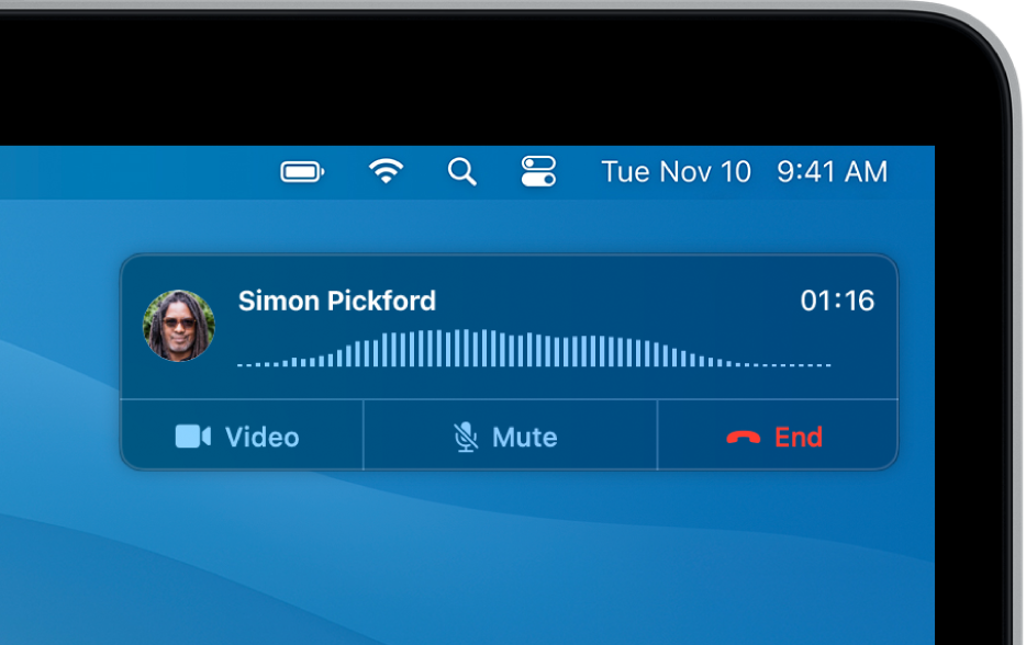 A notification appears in the top-right corner of the Mac screen, showing that a phone call is in progress.