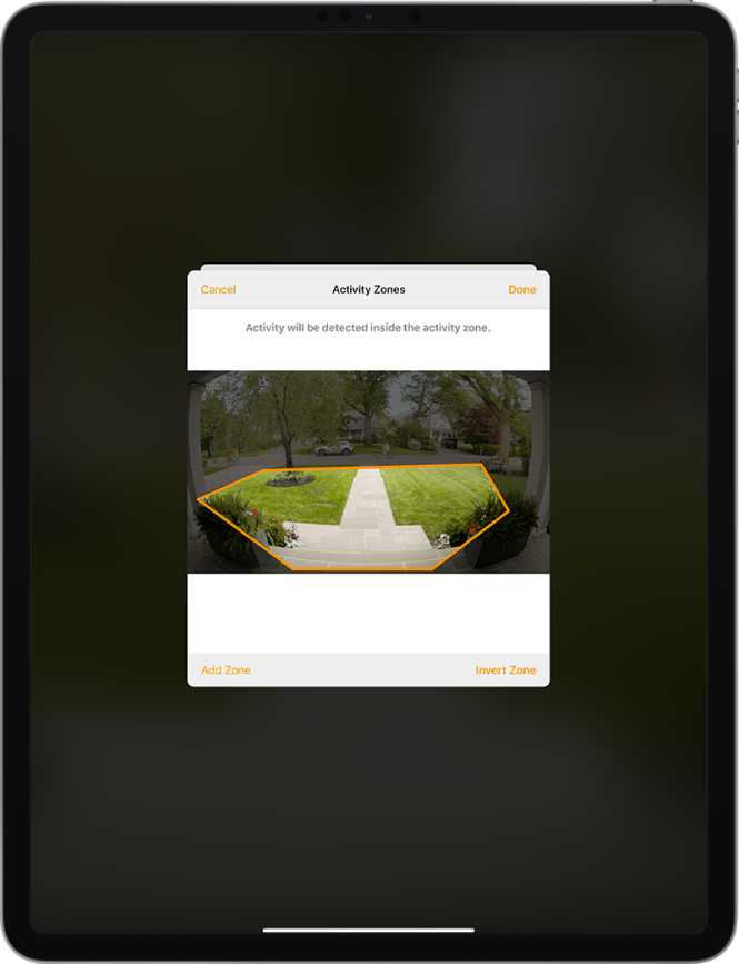The iPad screen showing an activity zone within an image taken by a doorbell camera. The activity zone encompasses a front porch and walkway, but excludes the street and driveway. Cancel and Done buttons are above the image. Add Zone and Invert Zone buttons are below.