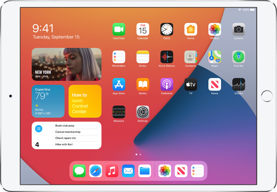 The iPad Home Screen. On the left side of the screen are the Photos, Weather, Tips, and Reminders widgets.