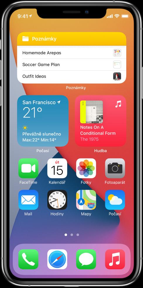 Plocha iPhonu. Vhorní části obrazovky jsou vidět widgety Poznámky, Počasí aHudba. Aplikace se nacházejí vdolní polovině obrazovky.