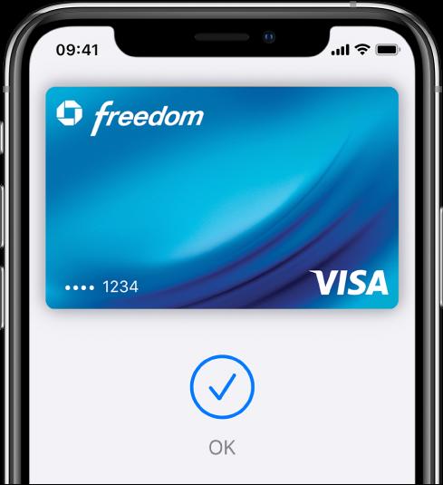 Um cartão de crédito no ecrã da Wallet. Por baixo do cartão, um visto e a palavra OK.
