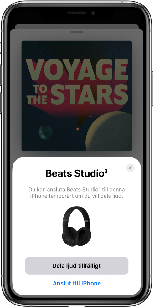 En iPhone-skärm med Beats-hörlurar. Nederst på skärmen finns en knapp för att dela ljud tillfälligt.