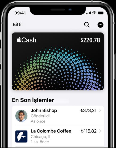 Wallet'ta Apple Cash kartı. Sağ üstte Daha Fazla düğmesi, en son işlemler de kartın altında gösteriliyor.
