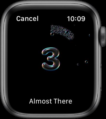 """Екранът Handwashing (Миене на ръце), отброяващ надолу от 3. В долния край се появяват думите """"Almost There"""" (""""Почти приключихте"""")."""