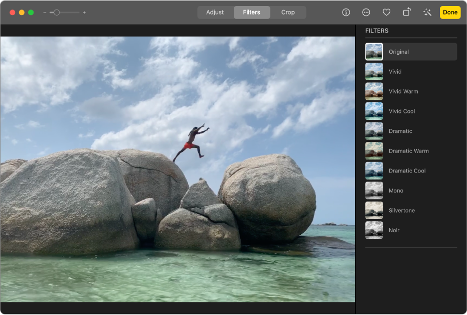 A video clip in editing view, with Filters selected at the top of the Photos window and the Filters pane showing filter options.