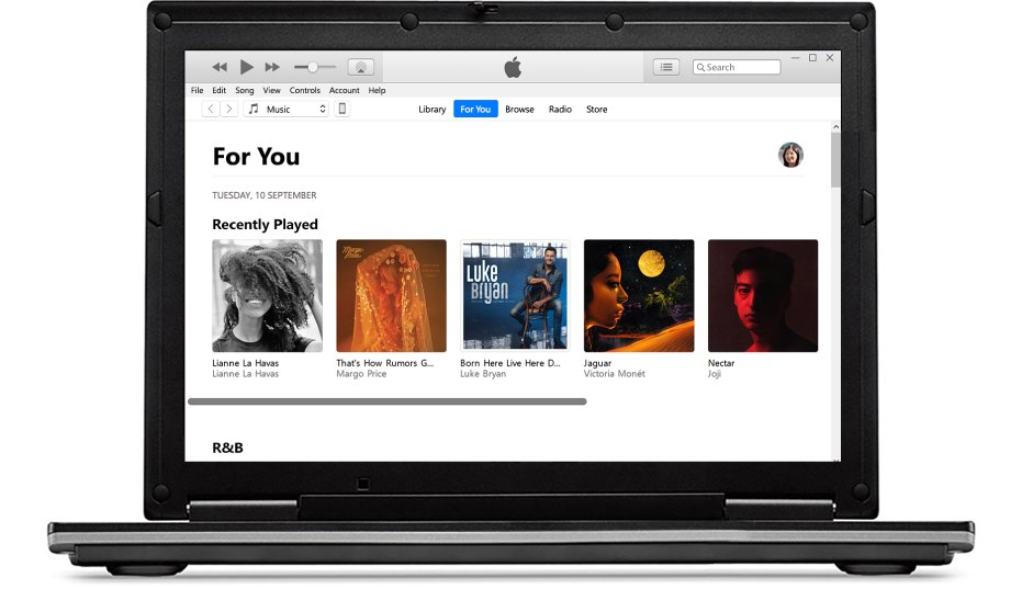 A PC and an iPhone with Apple Music For You.