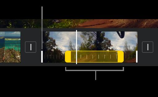 Phạm vi tốc độ với các bộ điều khiển phạm vi màu vàng trong clip video trong dòng thời gian, với các đường màu trắng trong clip cho biết các viền phạm vi.