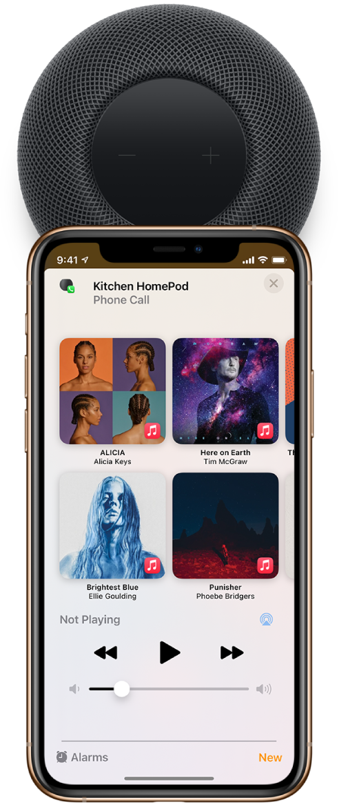 """On an iPhone, the Phone screen showing buttons while you're on a call. The iPhone is close to the top of HomePod, and an alert shows at the top of the screen saying """"Transfer to HomePod."""""""