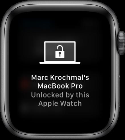 """Екран на Apple Watch, показващ съобщението, """"MacBook Pro на Марк Krochmal е отключен от Apple Watch""""."""
