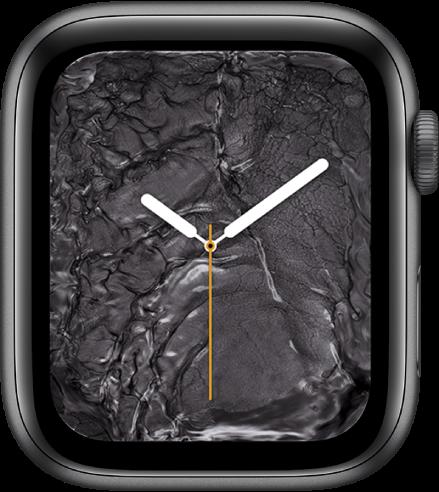 Ciferník Tekutý kov zobrazující ručičkové hodinky uprostřed atekutý kov okolo