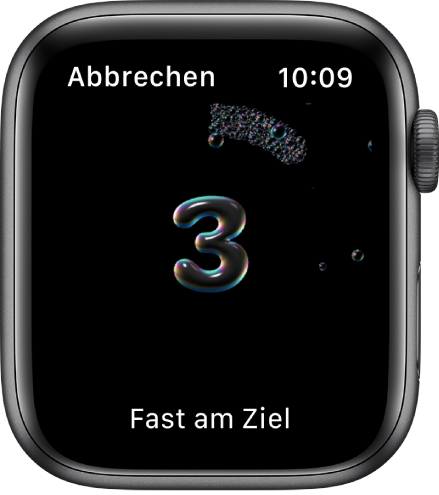 """Die Anzeige """"Händewaschen"""" mit einem Countdown beginnend mit 3. Unten auf dem Display wird der Text """"Fast am Ziel!"""" angezeigt."""