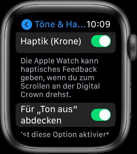 """Die Anzeige """"Haptik (Krone)"""" mit aktiviertem Schalter """"Haptik (Krone)"""". Darunter befindet sich die Taste """"Für 'Ton aus' abdecken""""."""