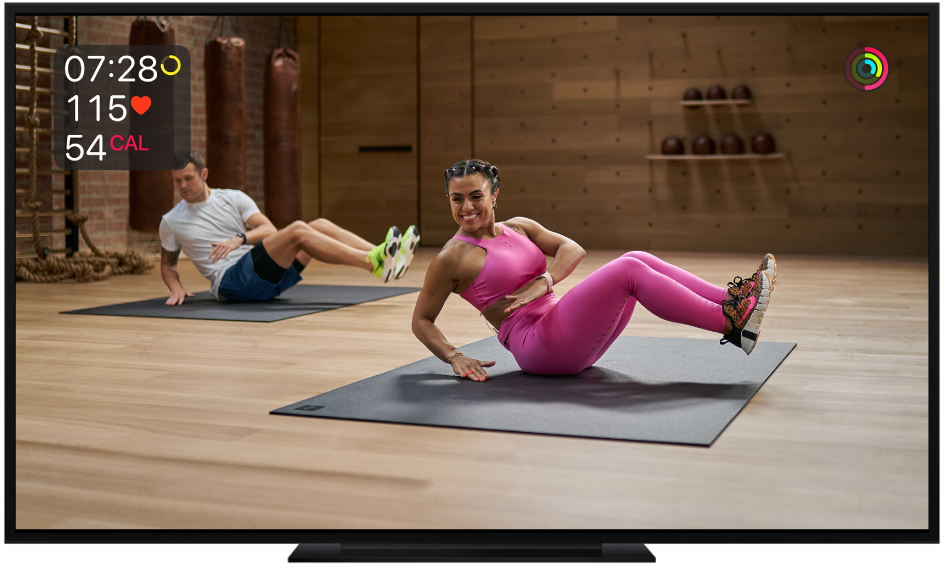 A TV showing an Apple Fitness+ core workout with metrics on the screen for time remaining, heart rate, and calories.