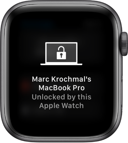 "Apple Watch screen showing the message, ""Marc Krochmal's MacBook Pro Unlocked by this Apple Watch."""