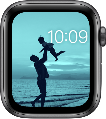 The Photos watch face shows a photo from your synced photo album. The time in near the top right.